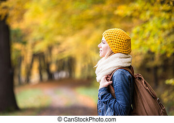 Beautiful woman on a walk in autumn forest