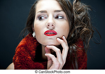 Beautiful woman on black background with jewelry