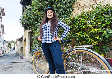 Beautiful woman on bycycle all the allley.