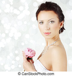 Beautiful woman on celebration background - bride, face