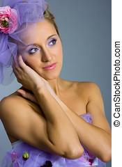 Beautiful woman on grey background - Young beautiful woman...