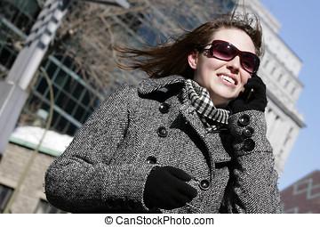 Beautiful woman on mobile phone