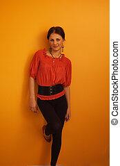 Beautiful woman on orange
