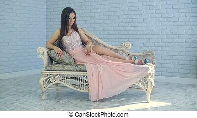 Beautiful woman on sofa