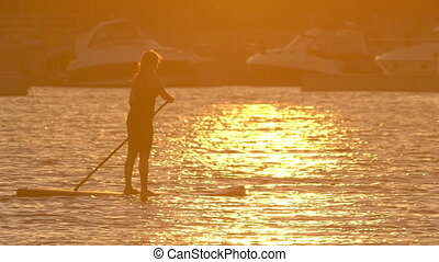 Beautiful woman on Stand Up Paddle Board. SUP.