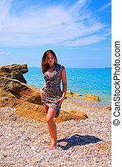beautiful woman on stone beach