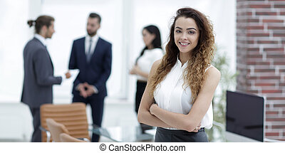 beautiful woman on the background of business people.