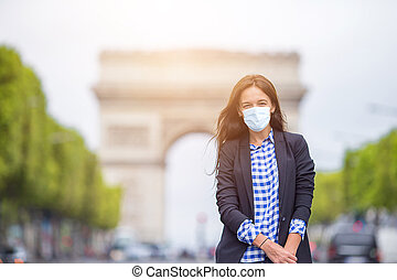Beautiful woman on the Champs Elysees in Paris