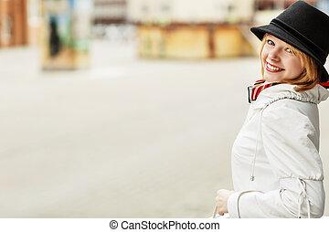 Beautiful woman on the city street