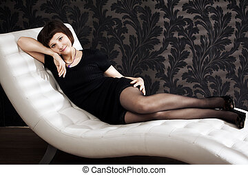 Beautiful woman on the couch