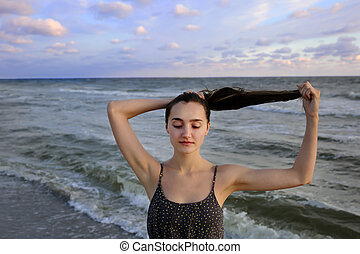 Beautiful woman on the sea coast