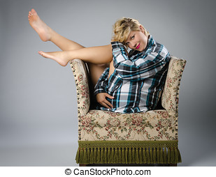 Beautiful woman on ugly old chair