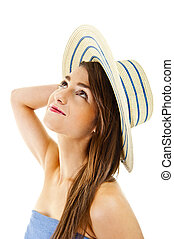 Beautiful woman on white background with long hair and hat look up