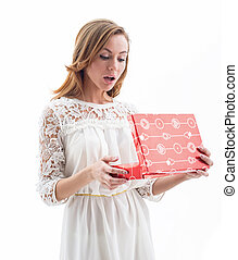 Beautiful woman opening present isolated on white background