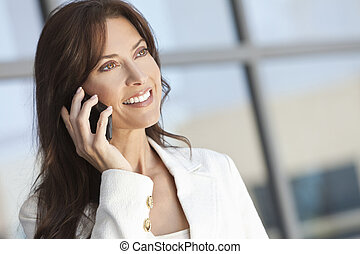 Beautiful Woman or Businesswoman Talking on a Cell Phone