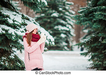 Beautiful woman outdoors on beautiful winter snow day in forest
