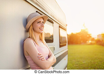 Beautiful woman outside the camper van - Beautiful young...
