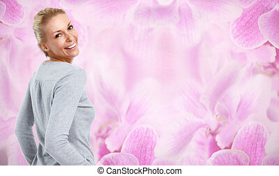 Beautiful woman over floral background.