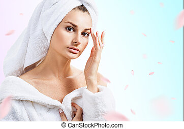 Beautiful woman over fresh blue background with swirl petals.