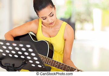 beautiful woman playing guitar