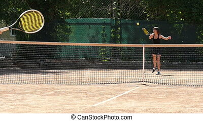 Beautiful Woman Playing Tennis Slow Motion