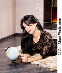 Beautiful woman playing with a globe