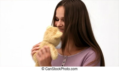Beautiful woman playing with a teddy bear