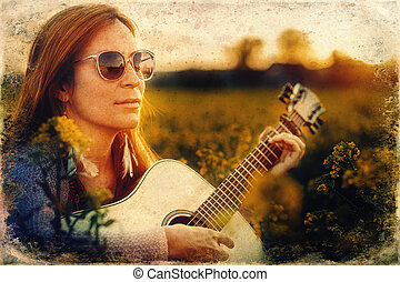 beautiful woman playing with guitar in nature. Old photo ...