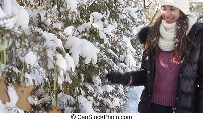 beautiful woman playing with snow