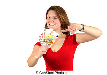 a smiling beautiful young business woman pointing at euro bills, isolated on white background