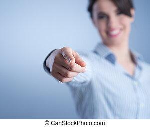Beautiful woman pointing
