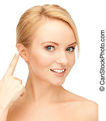 beautiful woman pointing to ear