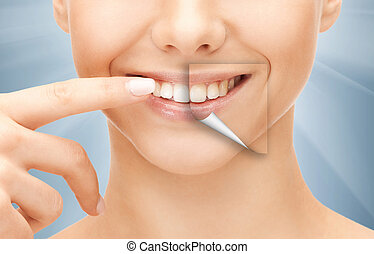 beautiful woman pointing to teeth - dental health concept -...
