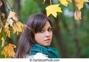 Beautiful woman portrait in autumn forest