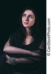 Beautiful woman portrait in low key