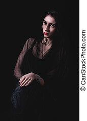Beautiful woman portrait on dark background
