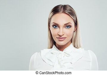 Beautiful woman portrait. Smart businesswoman in white shirt