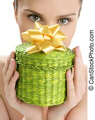 Beautiful woman portrait with a gift