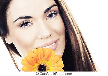 woman portrait with flower in studio