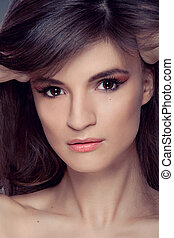 Beautiful woman portrait with Makeup and Healthy brown Hair