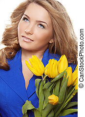 Beautiful woman portrait with tulips looking up