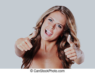 Beautiful woman porttrait showing thumbs up, isolated over a white background.