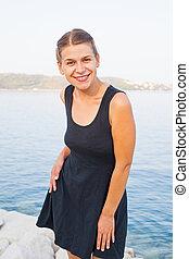 Beautiful woman posing at the seaside