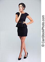 Beautiful woman posing in fashion dress