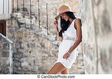 Beautiful woman posing in hat