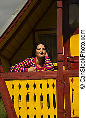 Beautiful woman posing in little  holiday cottage