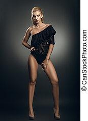 beautiful woman posing on dark background