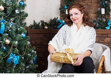 Beautiful woman posing with gift box