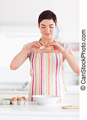 Beautiful woman preparing a cake