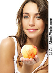 beautiful woman presenting an fresh apple
